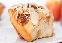 Apple cinnamon rolls with maple bourbon icing