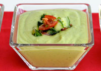 Avocado soup with tomato salsa