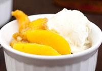 Bourbon poached peaches over vanilla bean ice cream