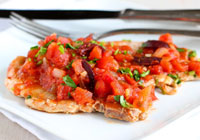Braised pork chops with tomatoes and olives