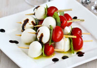 Caprese skewers with tomato, mozzarella and basil
