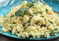 Couscous with grilled scallions, chickpeas and Moroccan sauce
