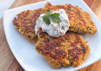 Crispy quinoa cakes with green chili cilantro sour cream dipping sauce