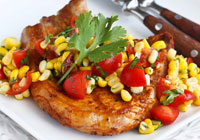 Grilled pork chops with corn and tomato salsa