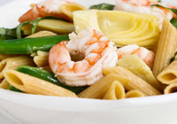 Basil shrimp pasta salad with artichokes and peas