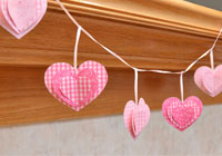 Make a 3-D paper heart garland for Valentine's Day