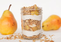 Pear, granola and cashew cream layered breakfast