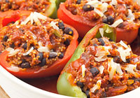 Quinoa and black bean-stuffed bell peppers