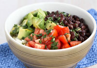 Rice bowl with black beans, avocado & cilantro dressing