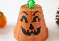 Terra cotta pot jack-o'-lanterns
