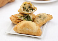 Vegetarian empanadas with spinach, artichoke hearts and cheese