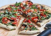 Vegetarian pizza with mushrooms and roasted peppers