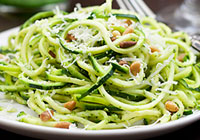 Zucchini pasta with pesto, pine nuts and Parmesan