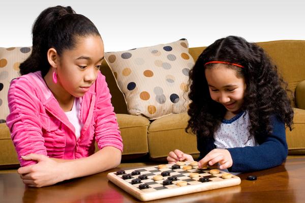 Girls playing checkers