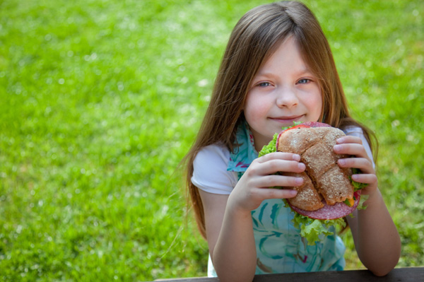 girl eating healthy sandwich