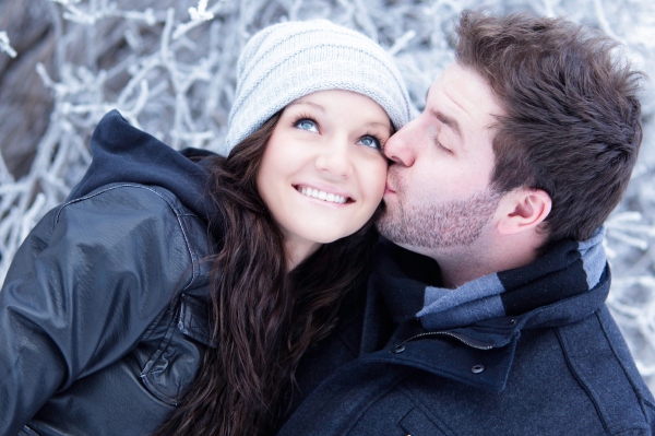 Man kissing girl in snow
