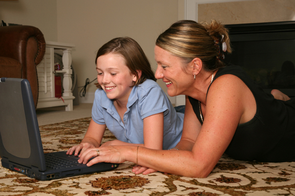 Mom with tween on computer
