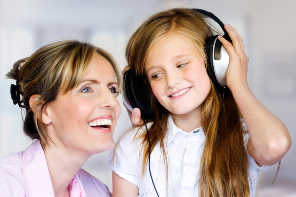 Mom and daughter with headphones