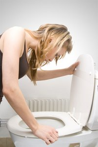 morning sickness woman  toilet nausea