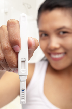 happy woman positive pregnancy test