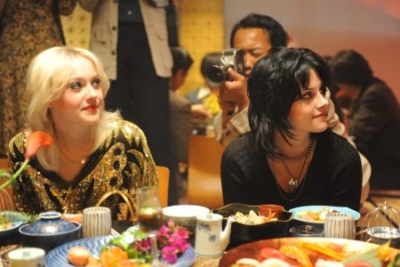 Dakota Fanning and Kristen Stewart bask in The Runaways success