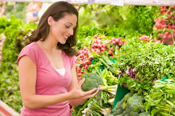 Woman shopping vegetables at grocery store