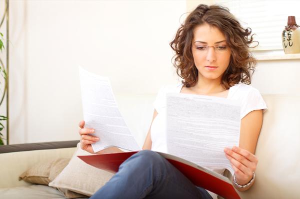 Woman reading IEP paperwork