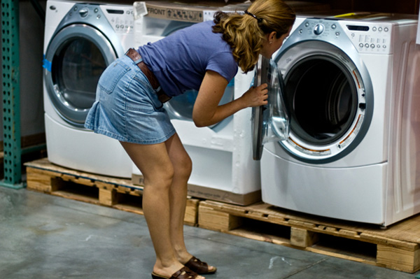 Woman shopping for green energy-efficient appliances