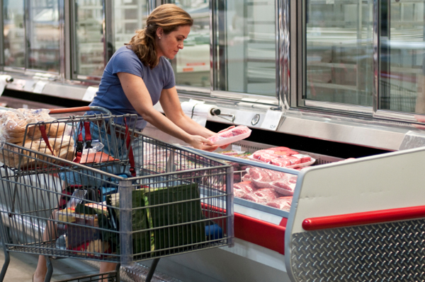 Woman shopping for organic meat