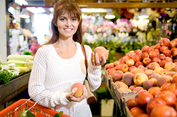 Woman shopping for organic apples
