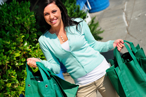 Woman with canvas shopping bags