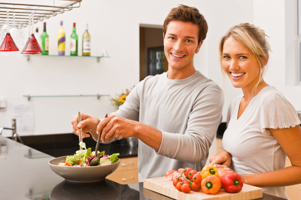 Couple making summer salad