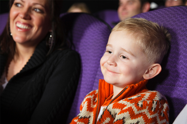 Little boy at movie theater