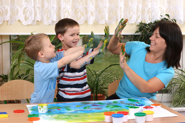 Mom fingerpainting with kids