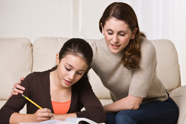 Mom helping teen daughter study
