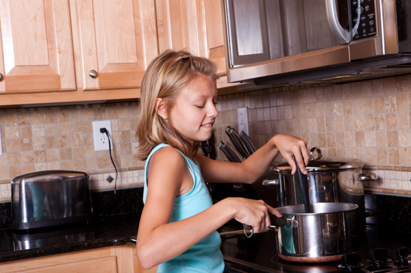 Teen girl cooking