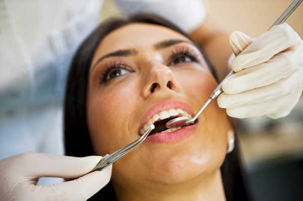 Woman at dentist getting enamel checked