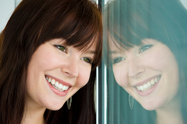 Woman smiling into mirror