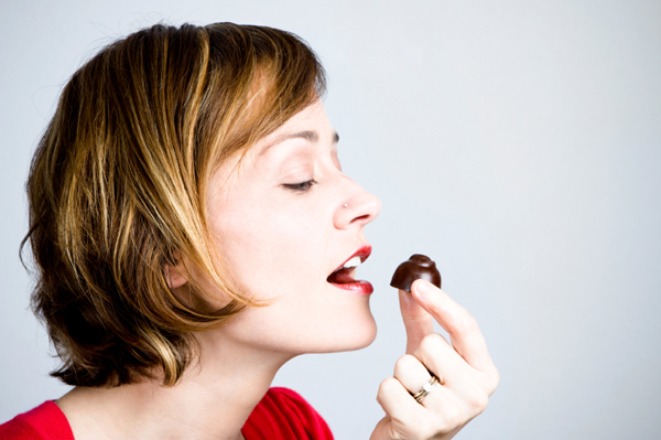 Woman snacking on chocolate