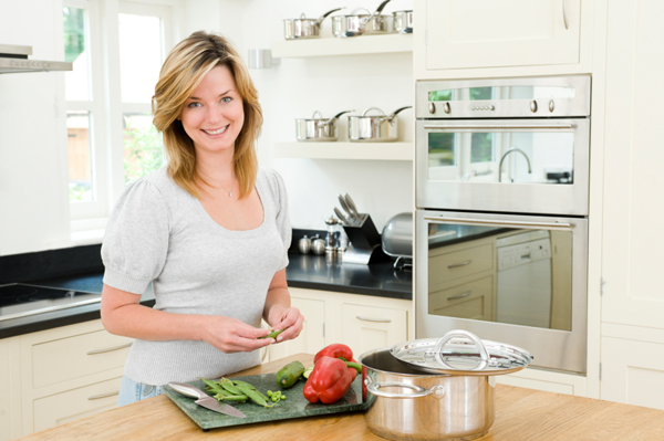 Woman using cutting board