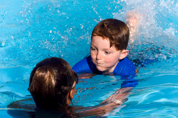 boy in swimming lessons