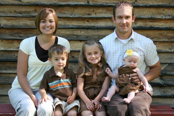 Family outside cabin