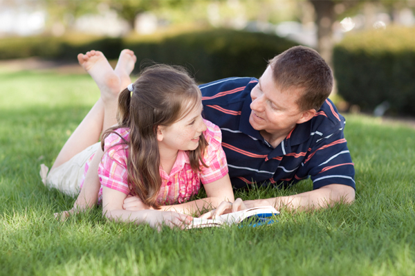 Father reading to daughter