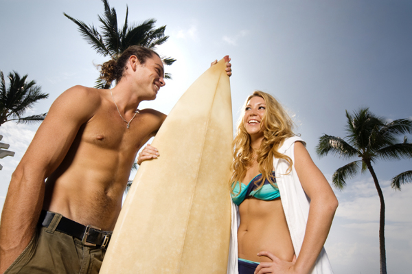 Woman flirting with surf instructor
