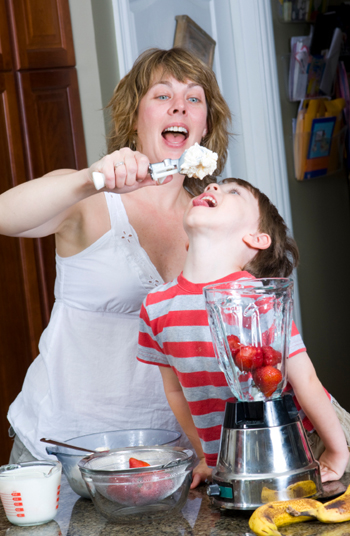 Mom and child having fun with ice cream
