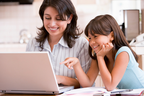 Mom researching schools with daughter