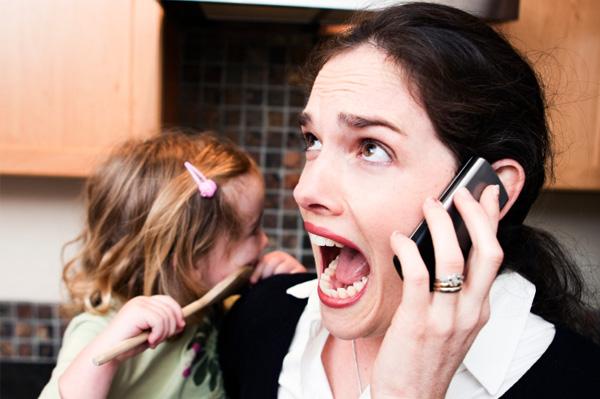 Stressed mother in ktichen