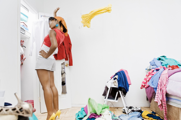 Woman going through closet