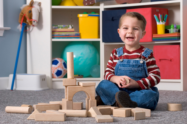Boy in organized playroom