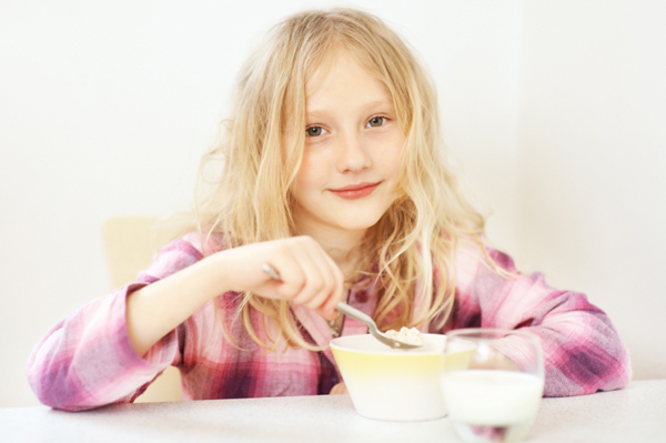 Little girl eating oatmeal